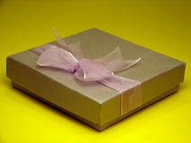Gift box. Nice gift box on yellow background Stock Image