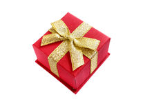 Gift box. Red gift box with gold ribbon isolated on white Royalty Free Stock Photo