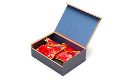 Gift box. Isolated gift box, 2 chinese style packages inside, red color. The people usually put the gold & jewelry with the package in China, such as wedding Royalty Free Stock Photos