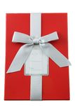 Gift Box. Red gift box with blank tag isolated on white Royalty Free Stock Images