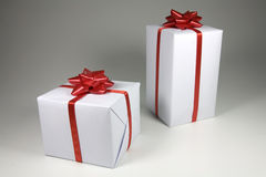 Gift box. Present box with red ribbon isolated on white background Royalty Free Stock Images