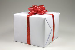Gift box. Present box with red ribbon isolated on white background Royalty Free Stock Photos