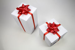 Gift box. Present box with red ribbon isolated on white background Royalty Free Stock Image
