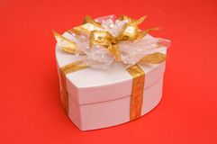 Gift box. With golden bow royalty free stock photo