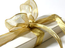 Gift Box. With gold ribbon and bow royalty free stock photo