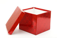 Gift Box. A single red gift box with the lid leaning on the side Royalty Free Stock Images