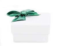 Gift box. White gift box with green bow on white background Stock Photography