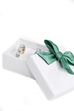 Gift box. White gift box with green bow on white background Stock Photos