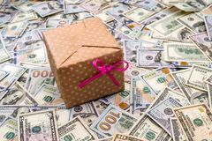 Gift box above dollars bills. As background Royalty Free Stock Photo