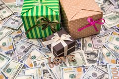 Gift box above dollars bills. As background Stock Photography