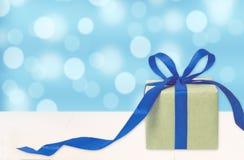 Gift box against bokeh background. Holiday present. Festive gift stock image