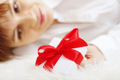 Gift box against happy beautiful woman Royalty Free Stock Image