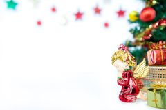 Gift box angel pray and Christmas tree toy decoration. or New Ye Stock Photos