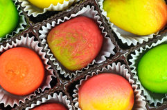 Gift box of assorted marzipan Stock Photos