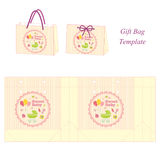 Gift box with baby accessories Royalty Free Stock Image