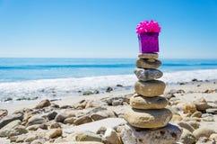 Gift box on Balanced rocks Stock Photo