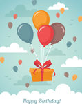 Gift box with balloons Stock Images