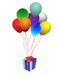 Gift box with balloons. A wrapped gift box with party balloons Stock Photos