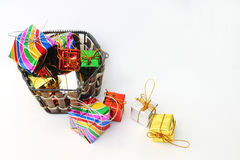 Gift box in basket Stock Photography