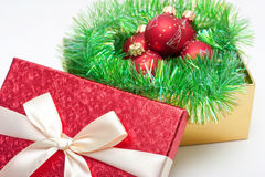 Gift box with baubles Stock Image