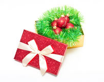 Gift box with baubles Stock Images
