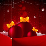 Gift box baubles and Christmas decorations background. Christmas Baubles with Bow in Red Gift Box Over Glowing Red Festive Background with Decorations Royalty Free Stock Photo