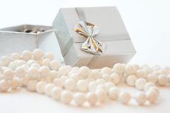 Gift box and the beads Royalty Free Stock Images