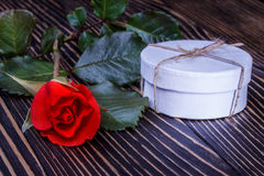 Gift box with beautiful rose on wooden background Royalty Free Stock Photography