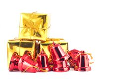 Gift box and bell on white or gray background. Royalty Free Stock Photos