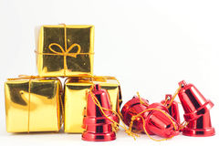 Gift box and bell on white or gray background. Gold gift box and red bell on white or gray background Royalty Free Stock Image