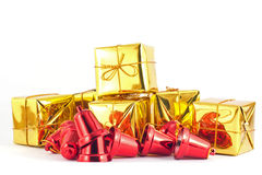 Gift box and bell on white or gray background. Gold gift box and red bell on white or gray background Stock Photos