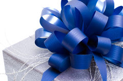 Gift box with big blue bow Royalty Free Stock Photography