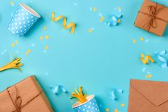 Gift box and birthday party things on a blue background.  stock photo