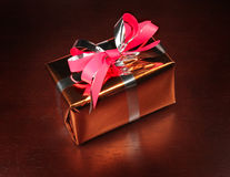 Gift box on black background Stock Images