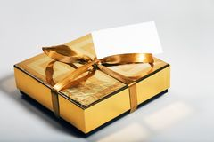 Gift box with blank card. On grey royalty free stock photography