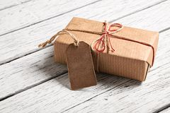 Gift box with blank gift tag Stock Photo