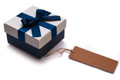 Gift box and blank label Royalty Free Stock Photography