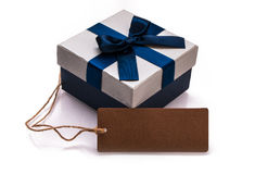 Gift box and blank label Royalty Free Stock Photo