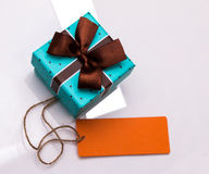 Gift box and blank label Royalty Free Stock Images