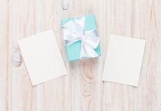 Gift box and blank photo frames Stock Image