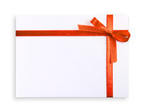 Gift Box. Blank gift tag tied with a bow of red satin ribbon. Isolated on white, with soft shadow Royalty Free Stock Image