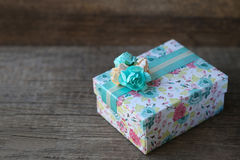 Gift box with blank tag on wood background Stock Photo