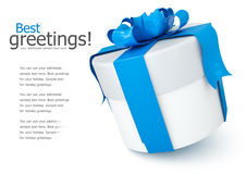 Gift box with blue bow. On white background Royalty Free Stock Photo