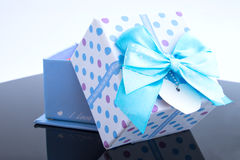 Gift box and blue bow. Royalty Free Stock Image