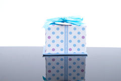 Gift box and blue bow. Royalty Free Stock Photo