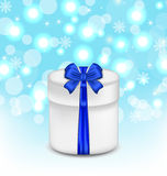Gift box with blue bow on glowing background. Illustration gift box with blue bow on glowing background - vector Royalty Free Stock Images