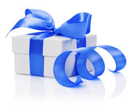 Gift box with blue bow isolated on the white background Stock Photos