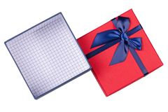 Gift box with blue bow. On a white background isolation, top view Stock Photos