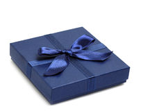 Gift box with blue holiday bow Royalty Free Stock Image