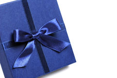 Gift box with blue holiday bow Stock Images